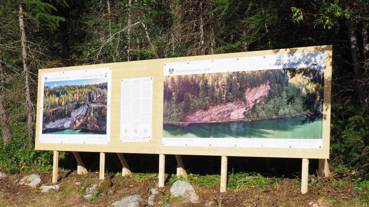 Über die Plakatwand beim Silser Bootshaus konnten sich Passanten über die beiden Wegvarianten informieren.