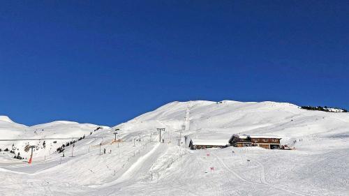 Daspö dumengia stan ils runals salda i'l territori da skis Minschuns (fotografia: David Truttmann).